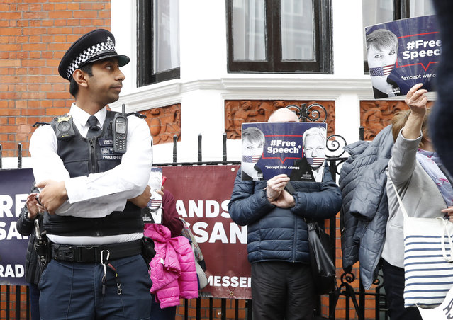 British police arrive and guard the Ecuadorian Embassy as protesters in support of Wikileaks founder Julian Assange demonstrate outside the embassy in London, Monday, May 20, 2019. Swedish authorities on Monday issued a request for a detention order against WikiLeaks founder Julian Assange, who is now jailed in Britain, a Swedish prosecutor said. (Photo by Alastair Grant/AP Photo)