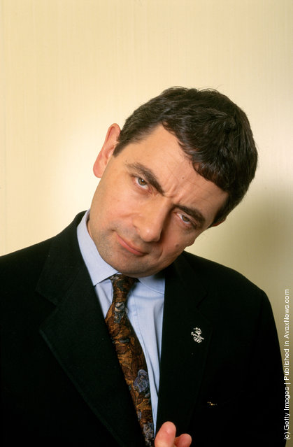 Rowan Atkinson poses for photographers before attending the world movie premiere of his BEAN movie