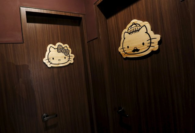 A view shows signs at the toilets of a Hello Kitty-themed Chinese restaurant in Hong Kong, China May 21, 2015. (Photo by Bobby Yip/Reuters)