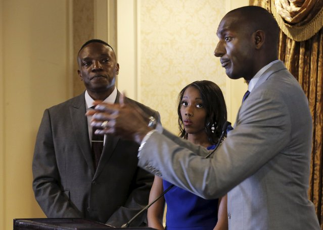 """Former contestant on """"The Apprentice"""", Dr. Randal Pinkett, speaks as fellow contestants Tara Dowdell (C) and Kwame Jackson (L) look on during a news conference to speak out against Republican U.S. presidential candidate Donald Trump in New York City, April 15, 2016. (Photo by Brendan McDermid/Reuters)"""