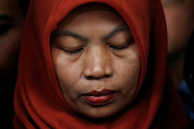 Baiq Nuril Maknun, a teacher on the island of Lombok who was jailed after she tried to report sexual harassment, reacts during a press conference with Indonesia's Law and Human Rights Minister Yasonna Laoly in Jakarta, Indonesia, July 8, 2019. (Photo by Willy Kurniawan/Reuters)