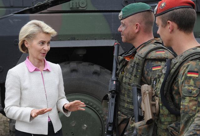 German Defense Minister Ursula von der Leyen speaks with German soldiers after the NATO Noble Jump exercise on a training range near Swietoszow Zagan, Poland, Thursday, June 18, 2015. (AP Photo/Alik Keplicz)