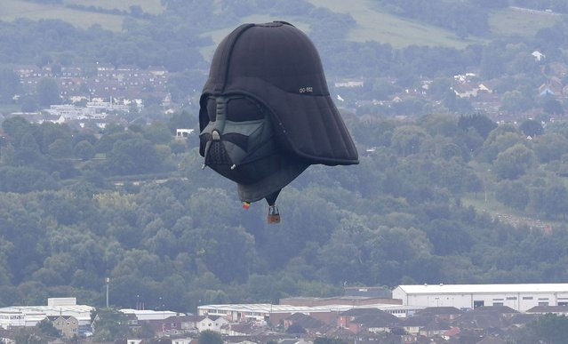 Darth Vader balloon above Clifton Suspension Bridge during the hot air balloons mass ascent at sunrise on the first day of the Bristol International Balloon Fiesta on August 8, 2019 in Bristol, England. The Bristol International Balloon Fiesta is Europe's largest annual meeting of hot air balloons, attracting over 130 hot air balloons from across the globe. (Photo by Finnbarr Webster/Getty Images)