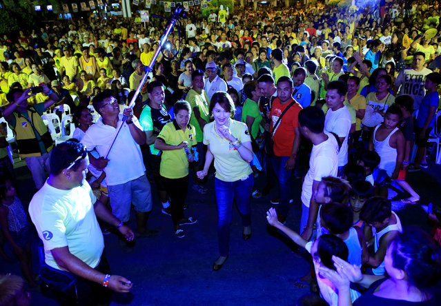 "Geraldine Roman, a transgender congressional candidate, (C) walks past her supporters during a ""Miting de Avance"" (last political campaign rally) for the national election in Orani town, Bataan province, north of Manila in the Philippines May 6, 2016. (Photo by Romeo Ranoco/Reuters)"