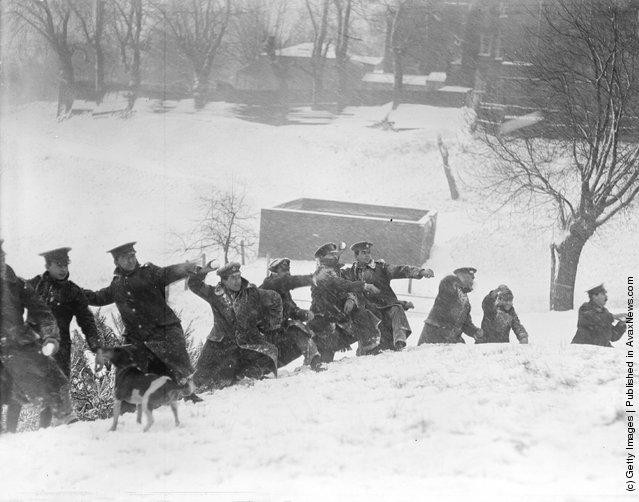 1917: Uniformed men enjoying a snowball fight in London