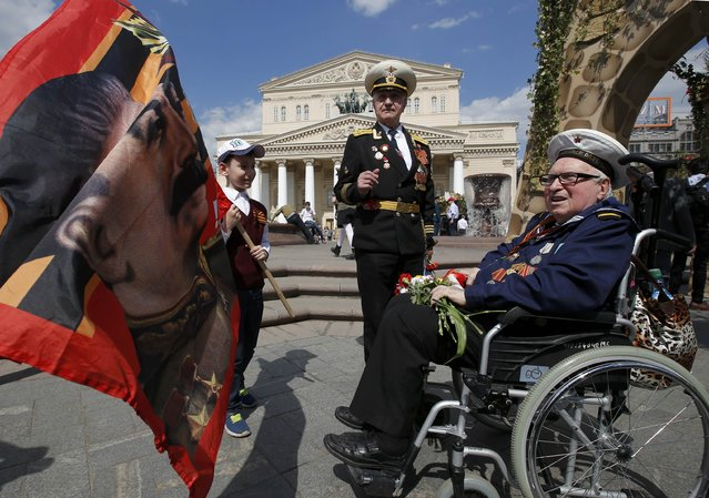Veterans take part in the Victory Day celebrations, marking the 71st anniversary of the victory over Nazi Germany in World War Two, in front of the Bolshoi Theatre in central Moscow, Russia, May 9, 2016. (Photo by Sergei Karpukhin/Reuters)