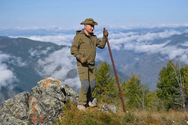 In this undated photo released by Russian Presidential Press Service, Russian President Vladimir Putin stands on a hill in Siberia during a break from state affairs ahead of his birthday. Russian president chose the Siberian taiga forest to go on a hike ahead of his birthday on October 7, 2019. (Photo by Alexei Druzhinin/Sputnik/Kremlin Pool Photo via AP Photo)