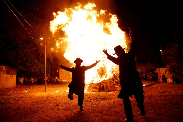 Ultra-Orthodox Jews dance next to a bonfire during celebrations for the Jewish holiday of Lag Ba-Omer in Jerusalem's Mea Shearim neighbourhood May 25, 2016. (Photo by Ronen Zvulun/Reuters)