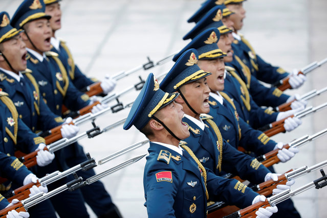 Members of the honour guard march during a welcoming ceremony at the Great Hall of the People in Beijing, China, October 25, 2019. (Photo by Jason Lee/Reuters)