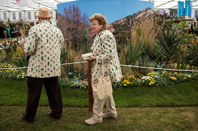A couple wearing matching cacti jackets view the displays at the Chelsea Flower Show on May 22, 2017 in London, England. (Photo by Jack Taylor/Getty Images)
