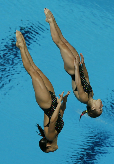 Puerto Rico's Jeniffer Fernandez Rodriguez and Luisa Maria Jimenez Aragunde compete in the women's synchronized 3m springboard diving heats at the Aquatics World Championships in Kazan, Russia, July 25, 2015. (Photo by Stefan Wermuth/Reuters)