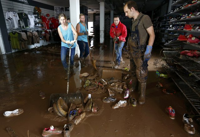 Shop employees clear flood damage at Intersport Schoell sporting goods store in the town of Schwaebisch Gmuend near Stuttgart, Germany, May 30, 2016. (Photo by Michaela Rehle/Reuters)