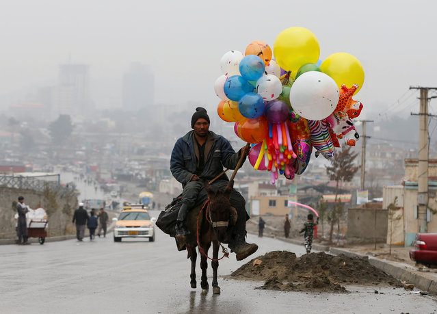 An Afghan man rides on his donkey, holding balloons for sale during Newroz Day celebrations, a festival marking their spring and new year, in Kabul, Afghanistan March 21, 2017. (Photo by Omar Sobhani/Reuters)