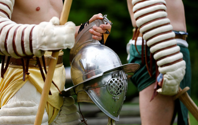 "Members of the ""Familia Gladiatoria Carnuntina"" prepare for a fight in the historic amphitheatre during the Roman Festival at the archeological site of Carnuntum in Petronell, Austria, June 11, 2016. (Photo by Leonhard Foeger/Reuters)"