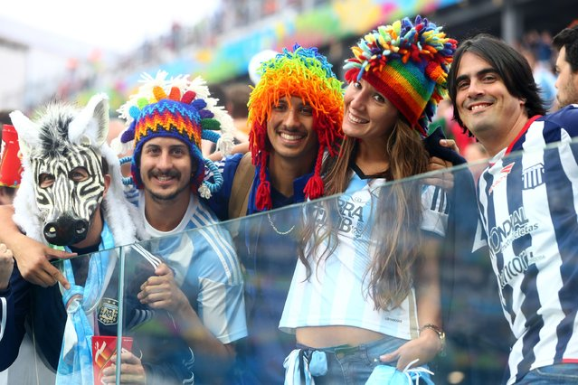 Argentina fans enjoy the atmosphere during the 2014 FIFA World Cup Brazil Semi Final match between the Netherlands and Argentina at Arena de Sao Paulo on July 9, 2014 in Sao Paulo, Brazil. (Photo by Jamie Squire/Getty Images)
