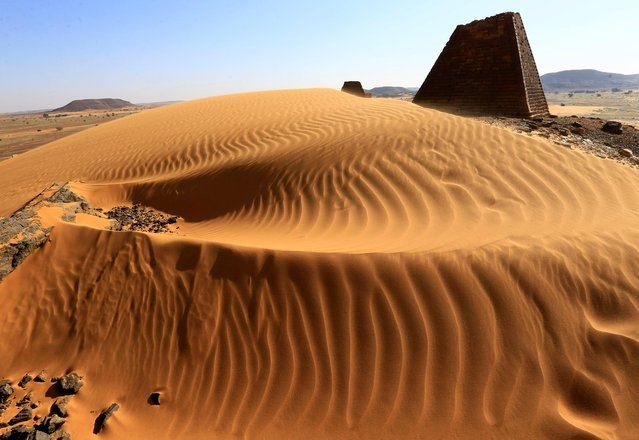 Creeping desert sands surround the Royal Cemeteries of Meroe Pyramids in Begrawiya at River Nile State, Sudan on November 10, 2019. Sudan has more – though smaller – pyramids than Egypt, but attracted only about 700,000 tourists in 2018 compared to some 10 million in its northern neighbor. Like the Egyptians, the Nubian Kush dynasty that ruled in the area some 2,500 years ago buried members of the royal family in pyramid tombs. Near Meroe's pyramids lie an array of temples with ancient drawings of animals and the ancient city of Naga, and there are more pyramids further north at Jebel Barka. (Photo by Mohamed Nureldin Abdallah/Reuters)