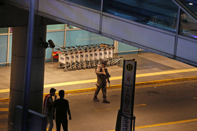 Turkish security officers gather outside Istanbul's Ataturk airport, Tuesday, June 28, 2016. (Photo by Emrah Gurel/AP Photo)