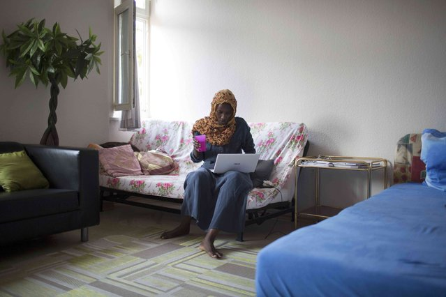 """Somalian migrant Fadhumo Musa Afrah uses a laptop in her flat in the  """"Sharehaus Refugio"""" community in Berlin, where Germans and migrants live together, Germany August 19, 2015. (Photo by Axel Schmidt/Reuters)"""