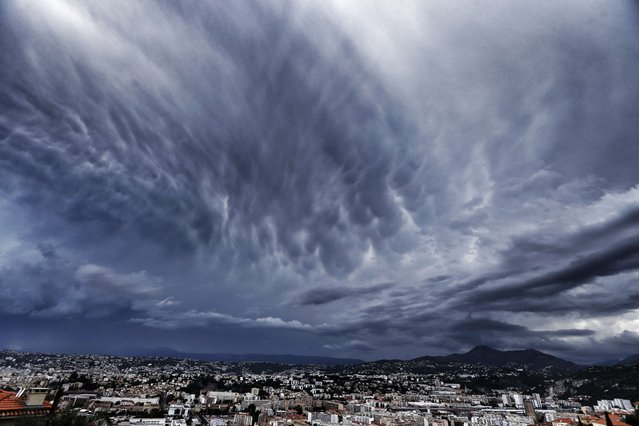 An approaching storm looms over the French riviera city of Nice, southeastern France, on July 29, 2014. (Photo by Valery Hache/AFP Photo)