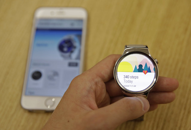 In this August 21, 2015, a new Android Wear smartwatch that is compatible with the Apple iPhone is displayed at Google's offices in San Francisco. Google is introducing an application that will connect Android smartwatches with Apple's iPhone, escalating the rivals' battle to strap their technology on people's wrists. (Photo by Eric Risberg/AP Photo)