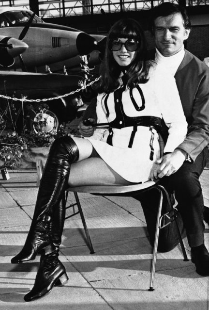 Playboy boss Hugh Hefner, right, and Miss Barbi Benton are pictured on their arrival at Gatwick Airport from Copenhagen, Sept. 3, 1969, London, England. Hefner is here for an indefinite period. (Photo by AP Photo)
