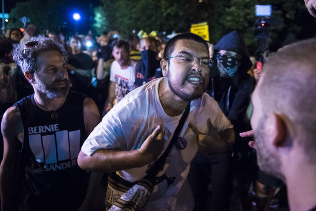 Protestors and anarchists argue near a fence surrounding the Wells Fargo Center on the third day of the 2016 Democratic National Convention in Philadelphia, PA on Wednesday July 27, 2016. (Photo by Jabin Botsford/The Washington Post)
