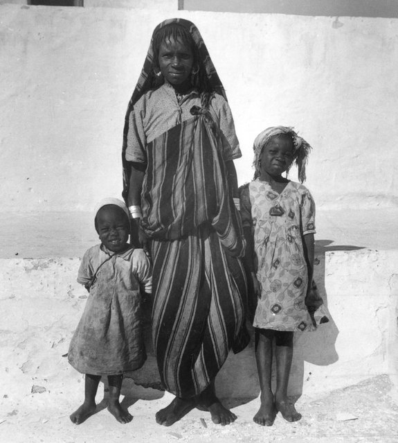A woman and her two daughters standing on a street in Tripoli, Libya, circa 1930. (Photo by Edward Charles Le Grice/Le Grice)