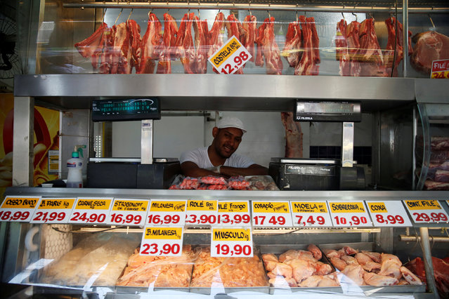 """Jeymerson Pereira, a 25-year-old butcher, poses for a portrait in Rio de Janeiro, Brazil, July 19, 2016. When asked what he felt about Rio de Janeiro hosting the Olympics, Jeymerson said, """"We don't need the Olympics, we need more schools and hospitals."""" He is also concerned that nothing will change for the poor in Rio de Janeiro, """"We would need to change the government and start afresh"""". (Photo by Pilar Olivares/Reuters)"""