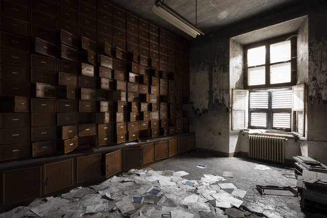 An office in an abandoned hospital. Old files litter the floor. (Photo by Thomas Windisch/Caters News)