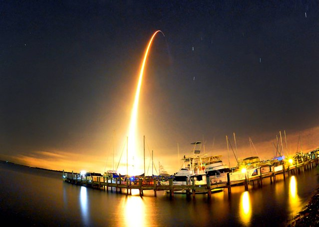 A SpaceX Falcon 9 rocket lights up the sky during liftoff at 1:52.03 a.m. Sunday morning September 21, 2014 for the resupply mission to the International Space Station photo taken at the Whitley Marina Cocoa. (Photo by  Craig Rubadoux/AP Photo/Florida Today)
