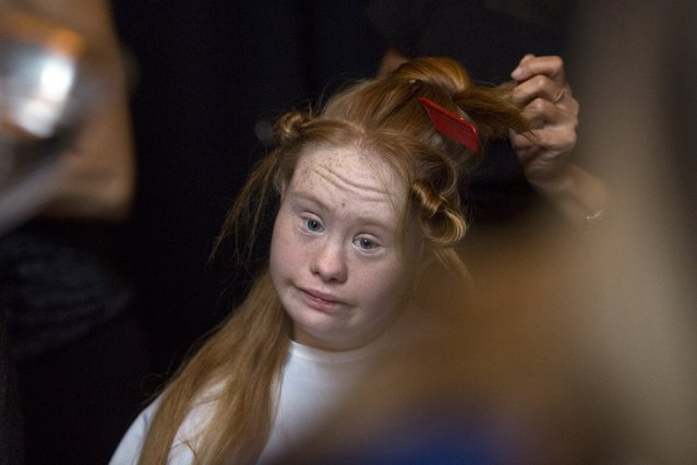 Madeline Stuart, an Australian model with Down Syndrome, is prepared backstage before the FTL Moda Presentation of the Spring/Summer 2016 collection during New York Fashion Week in Vanderbilt Hall at Grand Central Station, New York, September 13, 2015. (Photo by Andrew Kelly/Reuters)