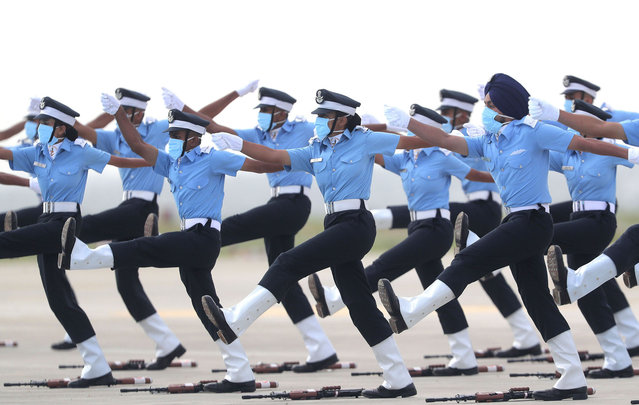 Indian Air Force (IAF) cadets march during a graduation parade at the Air Force Academy in Dundigal, on the outskirts of Hyderabad, India, Saturday, June 20, 2020. A total of 123 flight cadets including 19 women officers were commissioned as flying officers on Saturday on successful completion of their training, a press release said. (Photo by Mahesh Kumar A./AP Photo)