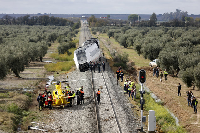 A train carriage is seen derailed near the town of Arahal, in the Seville province, Spain, Wednesday, November 29, 2017. Spanish officials said 27 people were injured Wednesday when a train carriage derailed after part of a track became flooded between the southern cities of Malaga and Seville. (Photo by Toni Rodriguez/AP Photo)