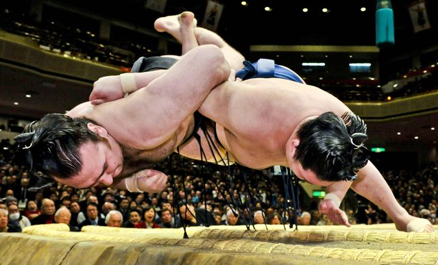 Junior champion Goeido, right, throws champion Kotooshu to win his bout during the 15-day New Year Grand Sumo tournament in Tokyo, January 17, 2013. (Photo by Kyodo News/Associated Press)