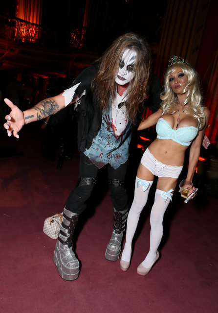 Sebastian Bach, left, and guest attend Treats! Halloween with Absolut Elyx in partnership with Utsinger Entertainment at the Los Angeles Theatre on Friday October 31, 2014 in Los Angeles, Calif. (Photo by Alexandra Wyman/Invision for Treats Magazine/AP Images)