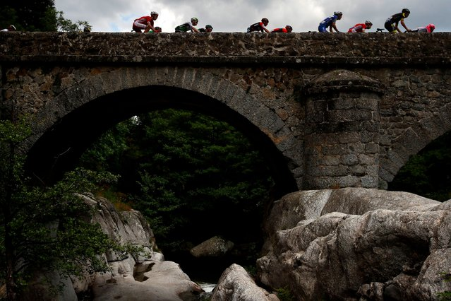 The pack of riders in action during the 14th stage of the 105th edition of the Tour de France cycling race over 188km between Saint-Paul-Trois-Chateaux and Mende, France, 21 July 2018. (Photo by Kim Ludbrook/EPA/EFE/Rex Features/Shutterstock)