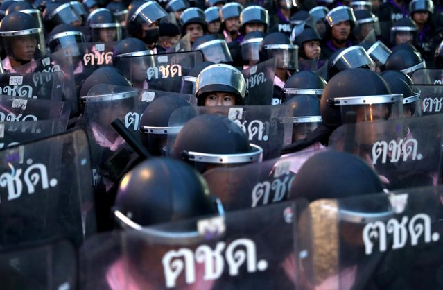 Police officers stand in position during a protest on the 47th anniversary of the 1973 student uprising, in Bangkok, Thailand on October 15, 2020. Thailand's government banned protests and the publication of sensitive news on Thursday in the face of escalating protests that have targeted King Maha Vajiralongkorn as well as Prime Minister Prayuth Chan'ocha, a former junta leader. (Photo by Athit Perawongmetha/Reuters)