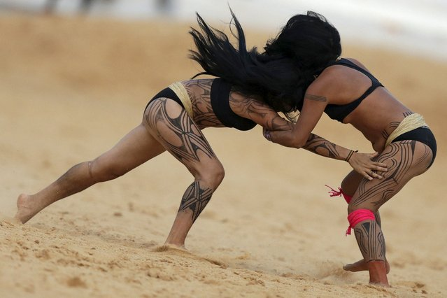 Indigenous women from the Kamayura tribe take part in a demonstration of Huka Huka fight at the first World Games for Indigenous Peoples in Palmas, Brazil, October 29, 2015. (Photo by Ueslei Marcelino/Reuters)