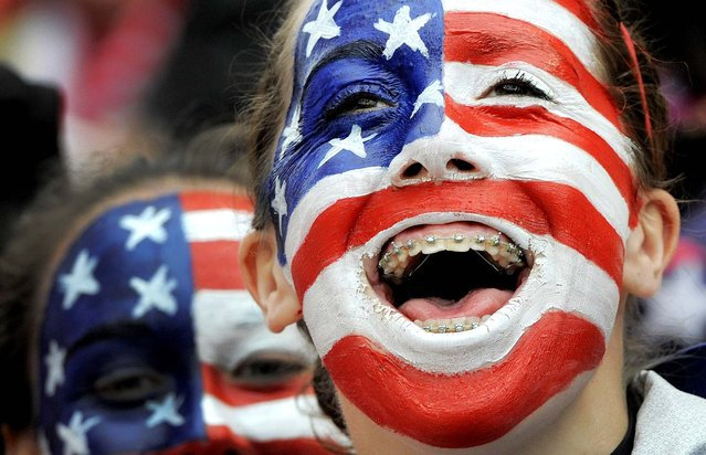 Fans of the United States cheer before the beginning of the international friendly women's soccer match between Germany and the United States in Offenbach, Germany, on April 5, 2013. (Photo by Jens Meyer/Associated Press)