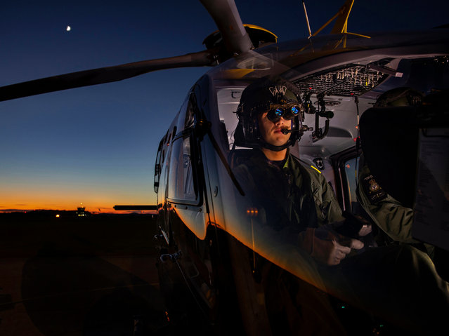 Personnel, 1st place. A student from No 1 flying training school at RAF Shawbury prepares a flight using night-vision goggles. (Photo by Mr Ian Forshaw/2020 RAF Photo Competition)