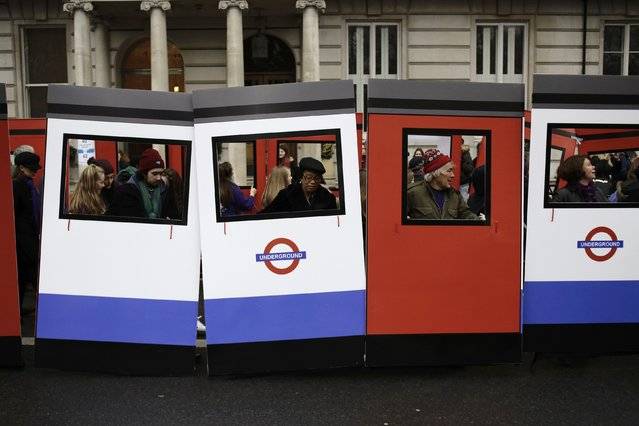 People carry parts of a wooden Underground Tube train at the start of the New Year's Day Parade in London January 1, 2015. (Photo by Kevin Coombs/Reuters)