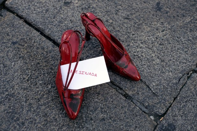 A pair of red shoes is seen placed at Plaza Mayor, as part of an installation to protest against gender violence and femicide, in Valladolid, Spain November 25, 2015. (Photo by Juan Medina/Reuters)