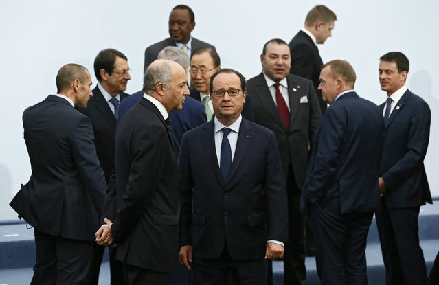 French President Francois Hollande (C) and Foreign Minister Laurent Fabius (C-L) await the arrival of world leaders for the family photoat the COP21 World Climate Change Conference 2015 in Le Bourget, north of Paris, France, 30 November 2015. The 21st Conference of the Parties (COP21) due to be held in Paris from 30 November to 11 December will proceed as planned, despite the terrorist attacks of 13 November. The aim is to reach an international agreement to limit greenhouse gas emissions and curtail climate change. (Photo by Ian Langsdon/EPA)