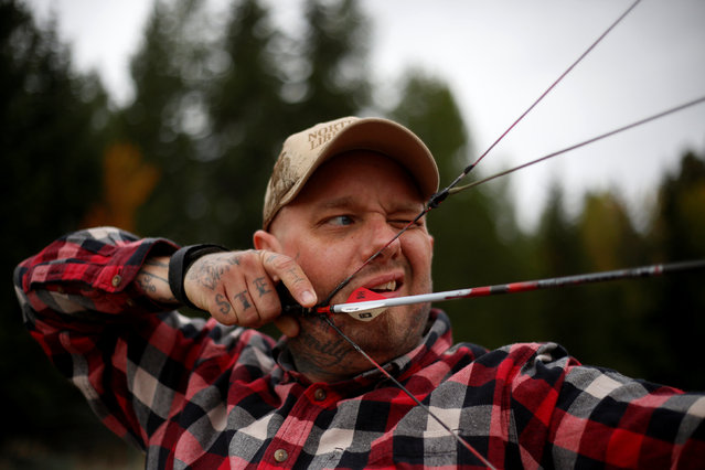 Jason Van Tatenhove, a member of the Oath Keepers, practices archery at his home in northern Montana, U.S. September 25, 2016. (Photo by Jim Urquhart/Reuters)