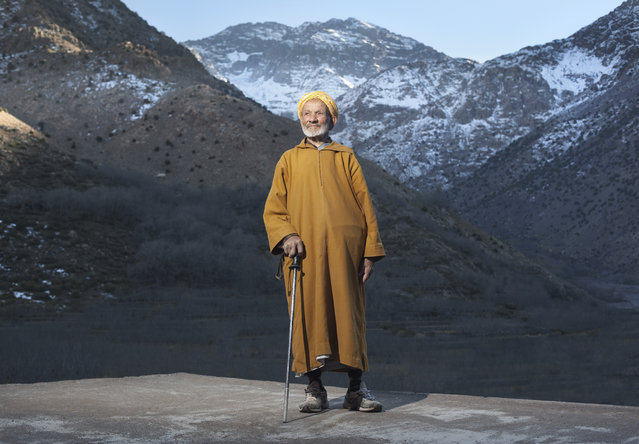 """""""Guardian of the Mountain"""". Hajj claims to be 112 years old. He knew the Europeans that made the first recorded ascent of North Africas highest mountain, Toubkal in 1923. Pictured in the background just catching the last of the evening light. Hajjs' father built and ran the Toubkal mountain refuge passing the responsibility to Hajj and through the generations to his son who is the current guardian. The Guardians of the Mountain. Location: Toubkal, Morocco. (Photo and caption by Joshua Exell/National Geographic Traveler Photo Contest)"""