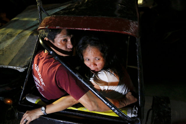 The mother of a man who was killed by two motorcycle-riding gunmen is comforted as police investigates in Manila, Philippines early October 29, 2016. (Photo by Damir Sagolj/Reuters)