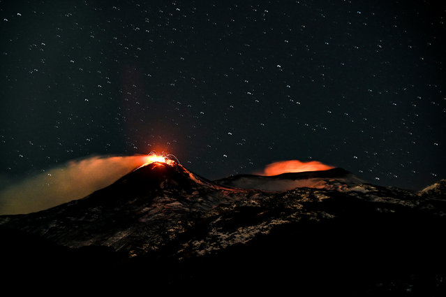 A night view of the southeast crater (L) and the Intra-crater in the Bocca Nuova and Voragine craters (R) of Etna volcano during explosive activity with lava fountains on February 15, 2021 in Catania, Italy. The National Institute of Geophysics and Volcanology, Etna Observatory, explained that since the early hours of 15 February a gradual intensification of explosive activity has been observed at the Southeast Crater while activity continued at the eastern mouths of the same crater. (Photo by Fabrizio Villa/Getty Images)