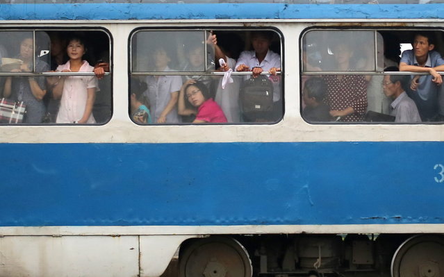 North Korean commuters ride on a tram on Monday, July 22, 2013 in Pyongyang North Korea. (Photo by Wong Maye-E/AP Photo)