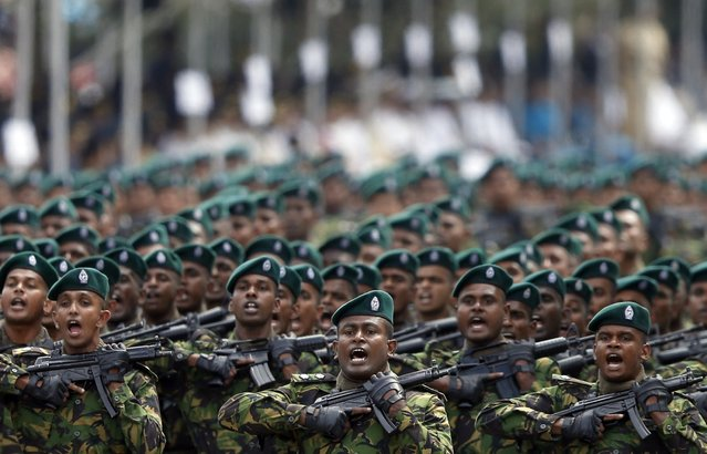 Sri Lanka's Special Task Force members march during the country's 67th Independence day celebrations in Colombo February 4, 2015. (Photo by Dinuka Liyanawatte/Reuters)