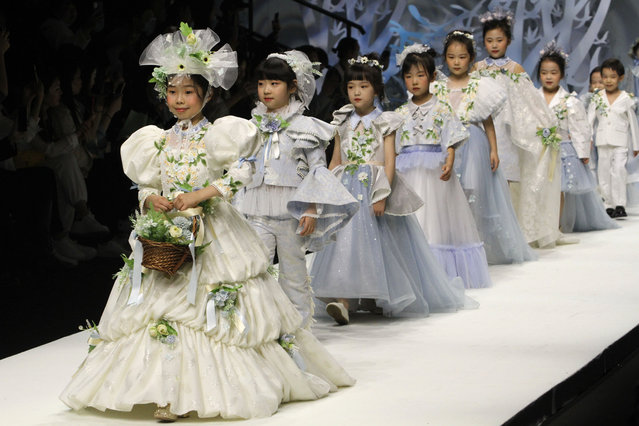 Child models line the catwalk during a children's fashion show in Beijing on March 28, 2021. (Photo by Ng Han Guan/AP Photo/Rex Features/Shutterstock)